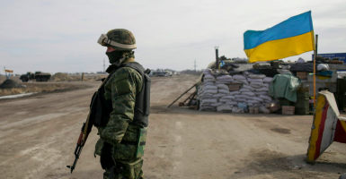 A Ukrainian serviceman stands guard at the checkpoint near Debaltseve, Donetsk area, Ukraine. (Photo: EPA/Newscom)