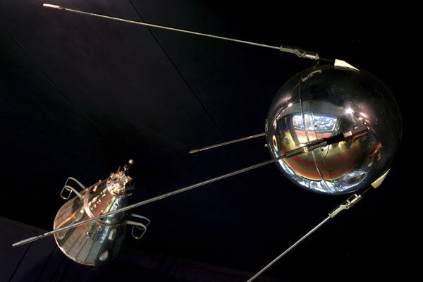 A back-up copy of the first Russian Sputnik satellite (R) and a small replica of the second Russian satellite. (Photo: EPA)