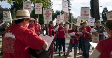 Teachers sing songs along the picket line as they strike outside Roosevelt High School in Seattle, Washington, September 9, 2015. Classes were canceled for 53,000 students as Seattle teachers and support staff marched in picket lines on Wednesday on what was supposed to be the first day of school, waging their first such strike in three decades after contract talks between the school district and the teachers' union failed. (Photo: Matt Mills McKnight/Reuters/Newscom)