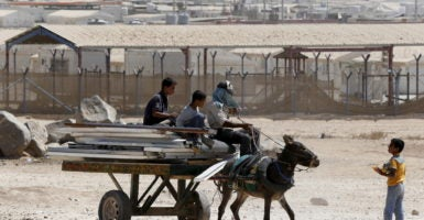 Syrian refugees in Jordan ride on a cart pulled by a donkey on Sept. 19, 2015. A recent government audit found much of the U.S. humanitarian relief efforts for embattled Syrians are plagued by fraud. (Photo: Muhammad Hamed /Reuters/Newscom)