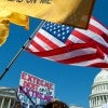 Tea party members on the East Front of the U.S. Capitol hold up signs and flags during a rally.(Photo: Douglas Graham/Roll Call/ Newscom/ Edited: Daily Signal)