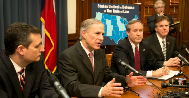 Sen. Ted Cruz, Texas Gov. Greg Abbott, Attorney General Ken Paxton and Lt. Gov. Dan Patrick talk about President Obama's immigration executive actions at a news conference Feb. 18 in Austin. (Photo: Jay Janner/TNS/Newscom)