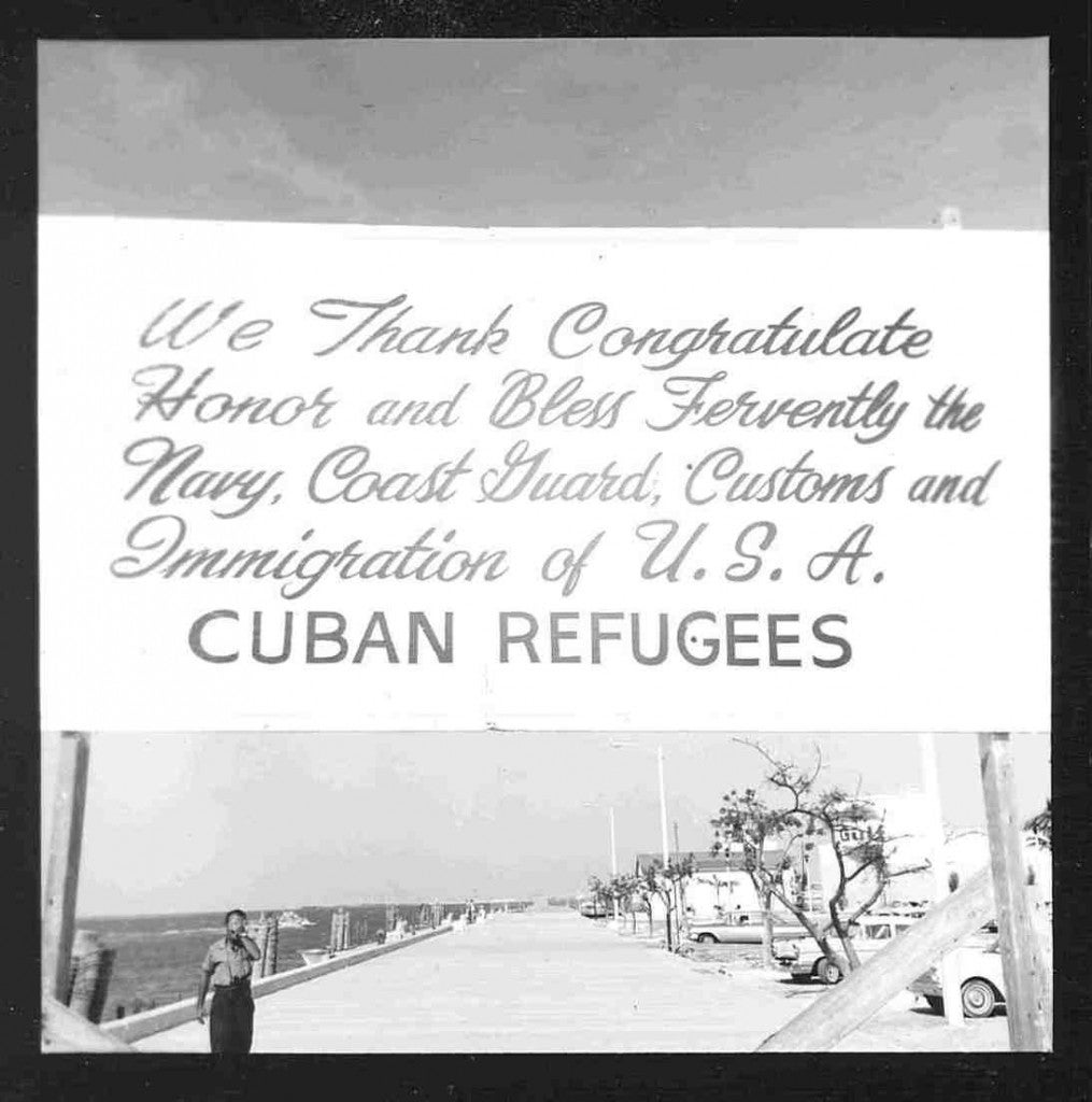 In 1965, the United States welcomed refugees with open arms, sending the Navy and Coast Guard to their rescue. In this photo, Cuban refugees show their thanks. (Photo: U.S. Coast Guard Camarioca Boatlift Collection)