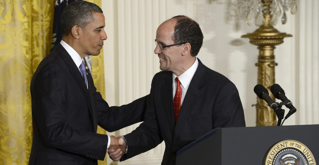 President Barack Obama shakes hands with Thomas Perez, whom he nominated for labor secretary in March 2013. Perez took office in July 2013. (Photo: Shawn Thew/Newscom)