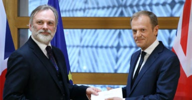 British Ambassador to the EU Tim Barrow, left, hands the Brexit letter to European Council President Donald Tusk in Brussels, Belgium, March 29, 2017. (Photo: Xinhua/Sipa USA/Newscom)