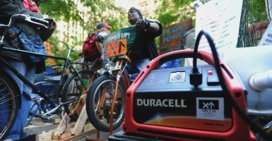 A man pedals a bicycle to generate power for a generator in New York City.  (Photo: Bryan Smith/ZUMAPRESS/Newscom)