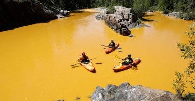 August 6, 2015 - Durango, Colorado: Kayakers Dan Steaves, Eric Parker and David Farkas find themselves surrounded Thursday, August 6th 2015, north of Durango Colo., by the toxic mine waste  that began flowing Wednesday into the Animas River from the Gold King Mine north of Silverton. (Photo: Jerry McBride/Durango Herald/Polaris /Newscom)