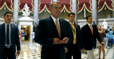 House Speaker John Boehner walks to the House Chamber for a vote on a package of trade bills in the U.S. Capitol on June 12. (Photo: Newscom)