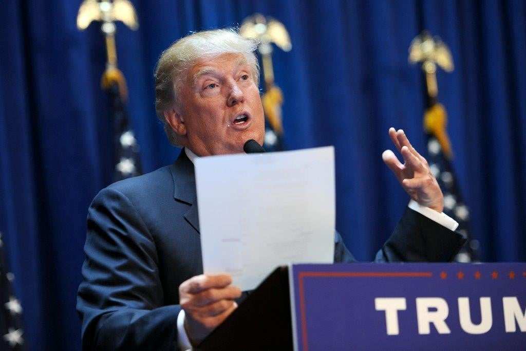 Donald Trump holds up a statement of his net worth after declaring his candidacy for president. (Photo: Anthony Behar/ Sipa USA/Newscom)