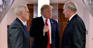 President Donald Trump talks with Homeland Security Secretary James Kelly, right, and Vice President Mike Pence during a visit to the Department of Homeland Security. (Photo: Barry Bahler /ZUMA Press/Newscom)