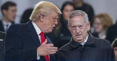 President Donald Trump speaks with Secretary of Defense James Mattis. (Photo: Erik S. Lesser /EPA/Newscom)
