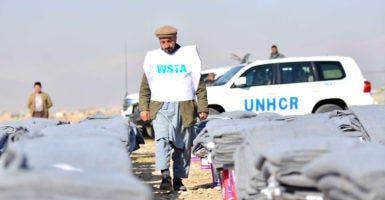 UNHCR, a United Nations agency that helps refugees, delivers materials to refugees in Afghanistan. The U.S. contributed more than $1.5 billion to the agency in fiscal 2016. (Photo: Dai He Xinhua News Agency/Newscom)