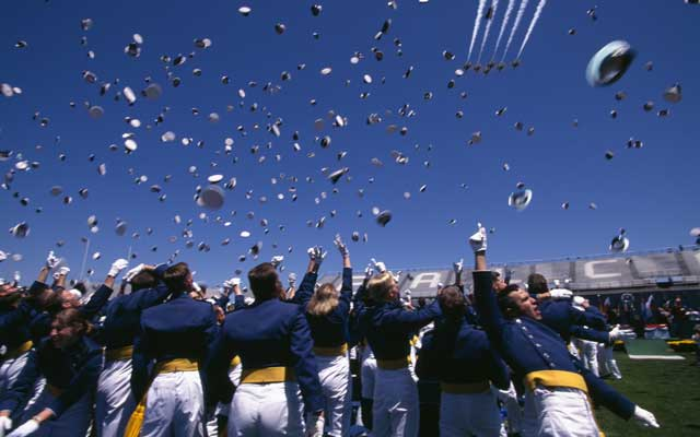 The United States Air Force (USAF) Thunderbirds fly over as USAF Academy Cadets toss their caps in the air at the completion of graduation ceremonies. (James Frank Stock Connection Worldwide/Newscom)