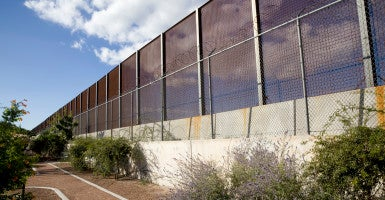 The border fence between El Paso, Texas and Juarez Mexico in a neighborhood park. (Photo: iStockPhoto)
