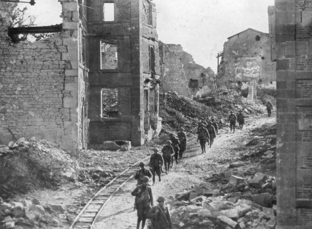 American soldiers passing through the ruins of Varennes, France during the Meuse-Argonne offensive. (Photo: The Print Collector Heritage Images/Newscom)