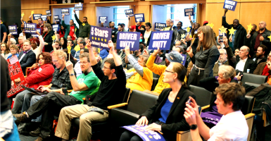 Seattle City Council voted to approve a measure that would allow ride sharing drivers for Uber and Lyft to unionize. (Photo: Matt Mills McKnight/Reuters/Newscom)