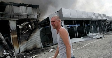 A man cries in front of his shop which was damaged Wednesday after shelling at a market in the outskirts of Donetsk, Ukraine. (Photo: Alexander Ermochenko/EPA/Newscom)
