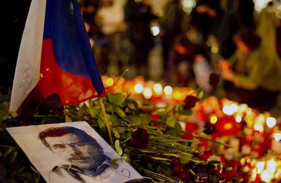 A picture of former Czech president Vaclav Havel lies among candles and floral tributes as people gather at Vaclavski square to pay their last respect to Havel in Prague, on December 22, 2011.