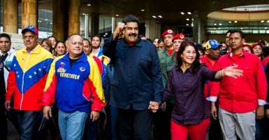 Venezuelan President Nicolas Maduro with first lady Cilia Flores. (Photo: Miguel Gutierez /EPA/Newscom)