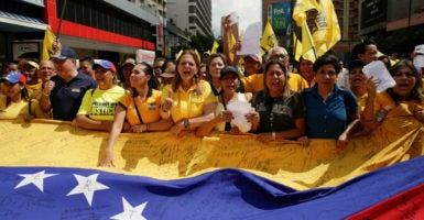 Venezuelan opposition supporters shout slogans as they protrest against shortage of medicines and demand a referendum to remove President Nicolas Maduro on Nov. 17, 2016. (Photo: Marco Bello/Reuters /Newscom)