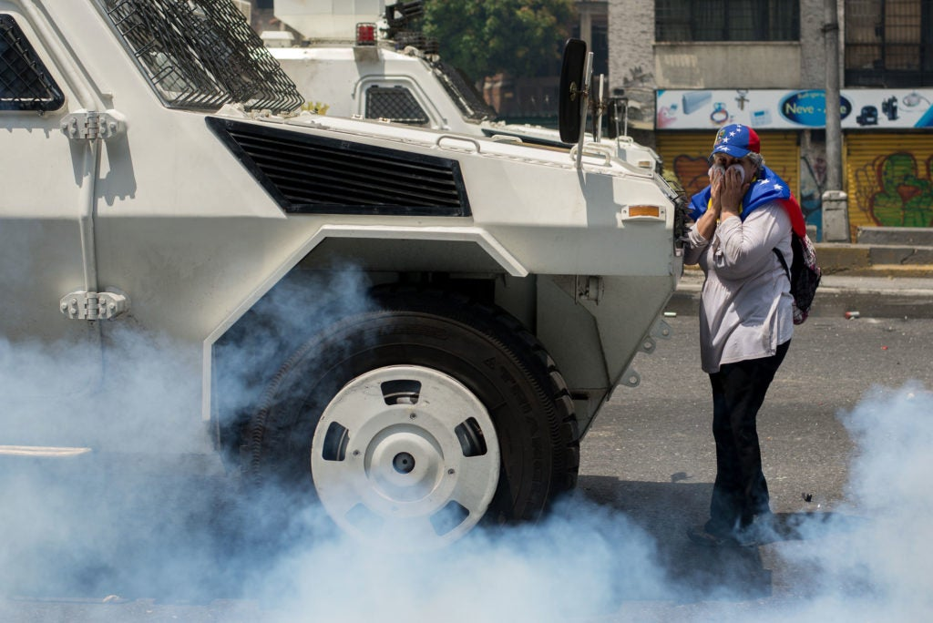 A woman blocks the police during a march in Caracas against Venezuelan President Nicolas Maduro. (Photo: Manaure Quintero/Zuma Press/Newscom)