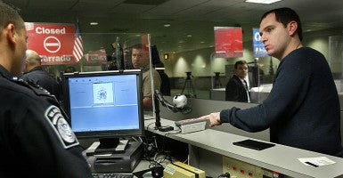 Travelers from countries participating in the visa waiver program face a quicker route to enter the U.S., but there are still substantial security checks, like fingerprinting. (Photo: C.W. Griffin/KRT/Newscom)