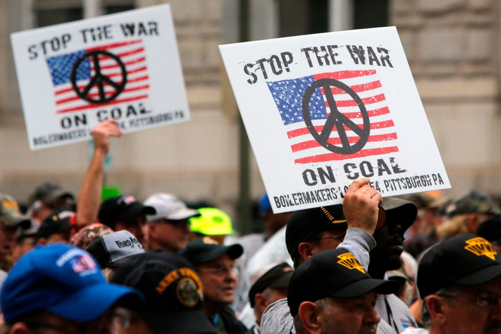 Members of United Mine Workers of America hold a rally outside the Environmental Protection Agency headquarters in Washington, D.C., Oct. 7, 2014. (Photo: Jonathan Ernst/Reuters/Newscom)