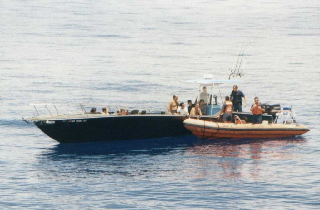 Smugglers charge hefty fees to outrun Coast Guard patrols. Sometimes they make it. Sometimes they don't, as was the case in this 2002 photo. (Photo: U.S. Coast Guard)