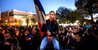 Lucie Warga waves a French flag during a solidarity rally outside the White House in tribute to the victims of the Nov. 13 terrorist attacks in Paris. (Photo: Jim Lo Scalzo/EPA/Newscom)