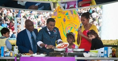 Weather and feature anchor NBC TODAY Show Al Roker (left), Chef Marcus Samuelsson (center) and First Lady Michelle Obama (right), prepare Shrimp Salad and Vegetable Tacos at the 'Kids Kitchen' activity center led by the White House chefs and celebrity guest chefs at the White House Easter Egg Roll in April 2012. The theme, 'Let's Go, Let's Play, Let's Move!' is the emphasis of First Lady Michelle Obama's Let's Move! initiative promoting health and wellness and encouraging children to lead healthy and active lives. (Photo: USDA/Bob Nichols)