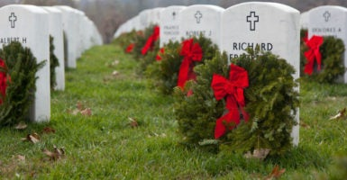 Each December, volunteers gather to lay wreaths at the tombstones of U.S. servicemen and women at the Arlington National Cemetery. (Photo: iStock Photos)
