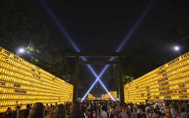 People visit the Yasukuni Shrine during the annual Mitama festival in Tokyo, Japan. (Photo: FRANCK ROBICHON/EPA/Newscom)