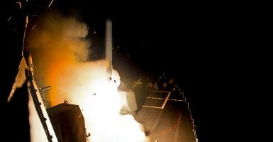The guided-missile destroyer USS Arleigh Burke (DDG 51) launches Tomahawk cruise missiles. (Photo: US Navy/Newscom)