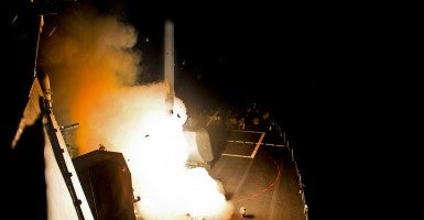 The USS Arleigh Burke, a guided-missile destroyer, launches Tomahawk cruise missiles Sept. 23. (Photo: U.S. Navy)
