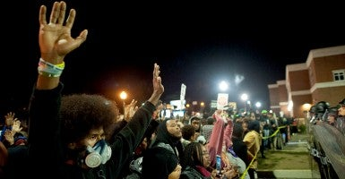 Protesters chant during a protest at the Ferguson Police Department in Ferguson, Mo. during a four-day event named Ferguson October. Weeks of protests have been sparked by the death of a black teenager. (Photo: Sait Serkan Gurbuz/Newscom)