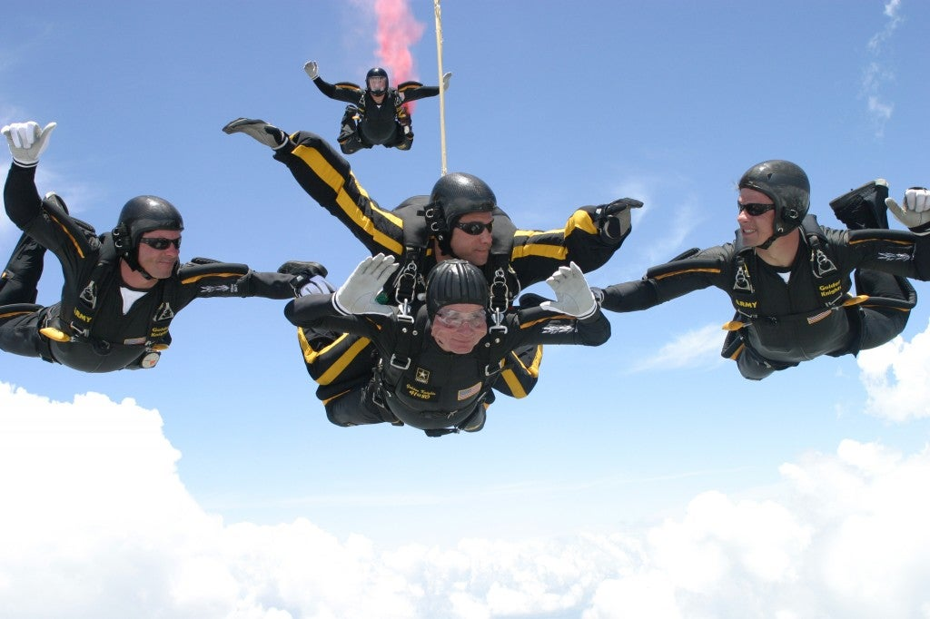 Former United States President George H.W. Bush jumps with the United States Army Golden Knights Parachute Team at the Bush Presidential Library near Houston, Texas on June 13, 2004 to celebrate his his 80th birthday.  His jump was witnessed by 4,000 people including Actor and martial-arts expert Chuck Norris and Fox News Washington commentator Brit Hume.  Both also participated in celebrity tandem jumps as part of the event.  Bush made the jump harnessed to Staff Sergeant  Bryan Schell of the Golden Knights. Bush was reportedly contemplating a free-fall jump, but officials said the wind conditions and low cloud cover made it too risky.  Former Soviet President Mikhail Gorbachev was also on site. He was reportedly invited by Bush to join the jump, but said he had never parachuted and was too old to start. (Photo: Photo by  US Army via CNP/ABACAUSA.COM)