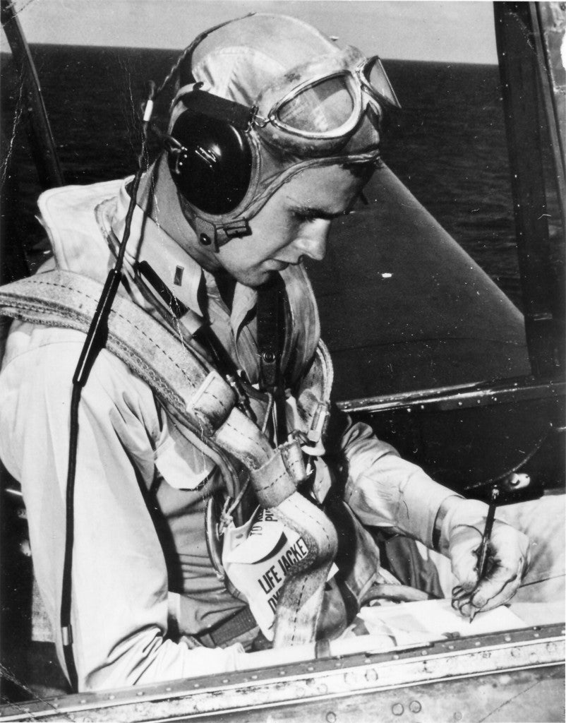 President George H.W. Bush as a United States Navy pilot seated in the cockpit of an Avenger. (Photo: White House via CNP/ABACAUSA.COM)