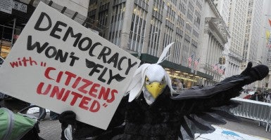 Citizens United members protest on Wall St. against the influence of corporate money on the politics Jan. 22, 2015. (Photo: Dennis van Tine/Newscom)