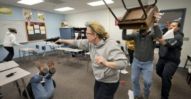 Independence, MO police hold an active shooter training session for staff of Pioneer Ridge Middle School (Photo: Keith Myers/TNS/Newscom)
