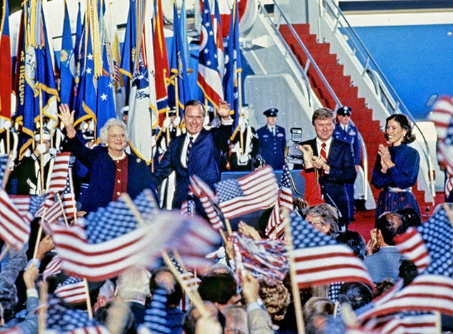 United States President-elect George H.W. Bush and Vice President-elect Dan Quayle return to Andrews Air Force Base, just outside Washington, D.C. after winning the 1988 Presidential Election on November 9, 1988. From left to right: Barbara Bush, President-elect Bush, VP-elect Quayle, and Marilyn Quayle. (Photo: Ron Sachs/CNP/AdMedia)