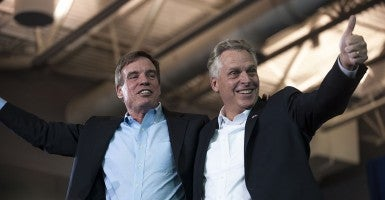 Former Gov. Mark Warner, left, and Gov. Terry McAuliffe embrace an agenda that gives public funds to private companies. (Photo: Pete Marovich/CNP/AdMedia/Newscom)