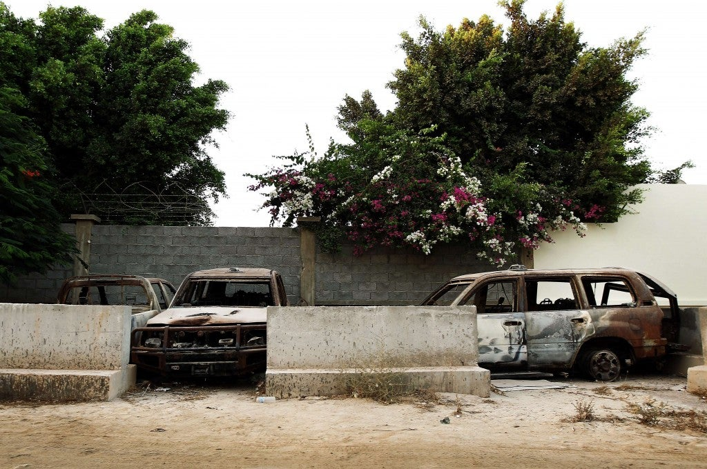 A picture taken on September 10, 2013 shows the wreckage of burnt cars outside the main gate of the US consulate in Benghazi. (Photo: ABDULLAH DOMA/AFP/Getty Images)