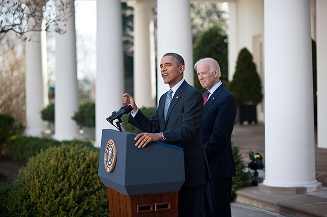 President Obama speaks about the Affordable Care Act with Vice President Joe Biden in the Rose Garden at the White House in Washington on April 1, 2014. (Photo: Nicholas Kamm/Getty/Newscom)
