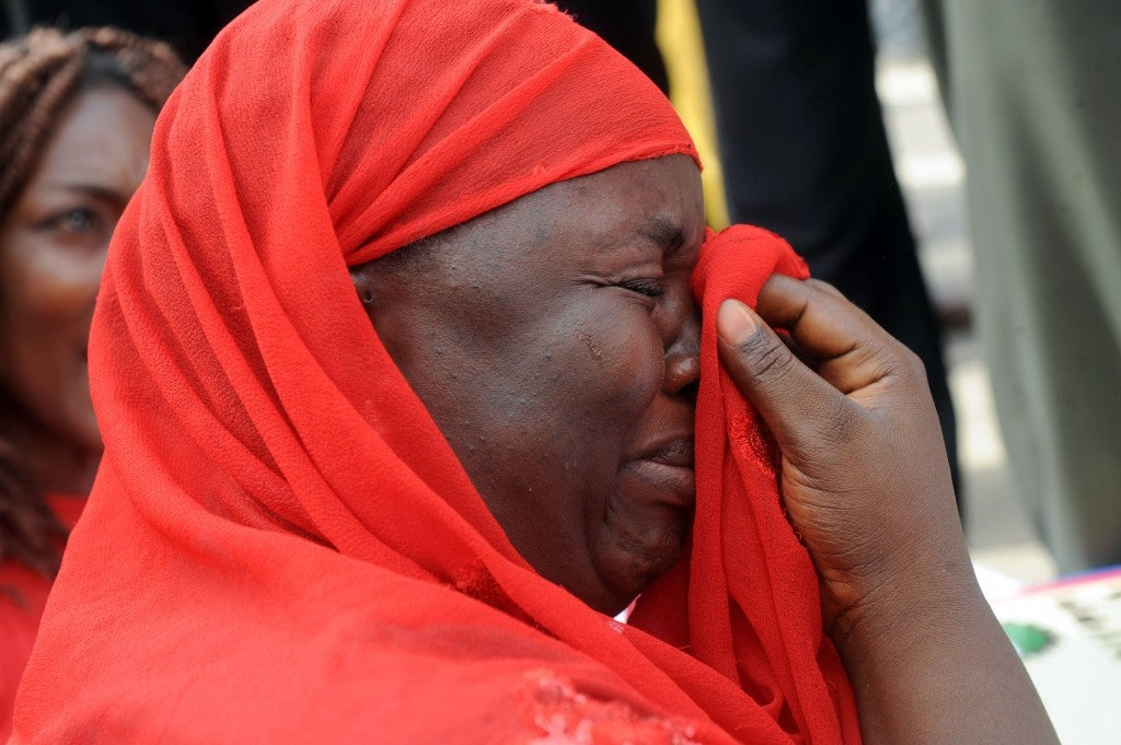One of the mothers of the missing Chibok school girls wipes her tears as she cries during a rally by civil society groups pressing for the release of the girls in Abuja. (Photo: PIUS UTOMI EKPEI/AFP/Getty Images/Newscom)