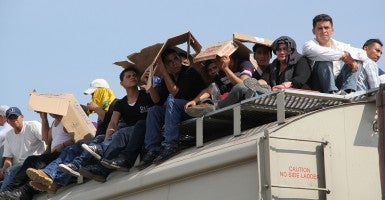 Central American immigrants sit atop the so-called La Bestia (The Beast) cargo train, in an attempt to reach the Mexico-US border, in Arriaga, Chiapas state, Mexico on July 16, 2014. (Photo: Elizabeth Ruiz/Getty Images/Newscom)