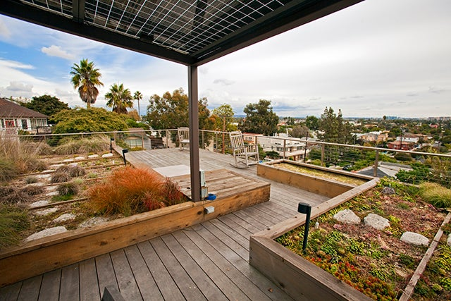 A multilevel, prefab green home in Santa Monica, Calif., uses recycled materials and Forest Stewardship Council cedar. (Photo: Newscom)