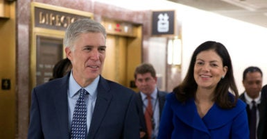 Kelly Ayotte, right, helped guide Judge Neil Gorsuch, left, through the Senate's confirmation process. (Photo: Shawn Thew/EPA/Newscom)