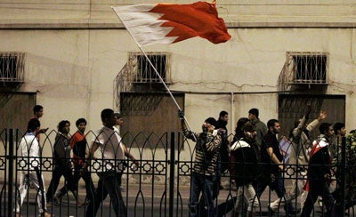 Bahraini Shiite demonstrators wave their national flag