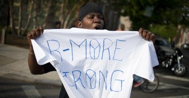 A demonstrator holds a t-shirt reading 'B-more Strong' during a march towards Pennsylvania and W North Avenue in Baltimore May 2. (Photo: John Taggart/EPA/Newscom)