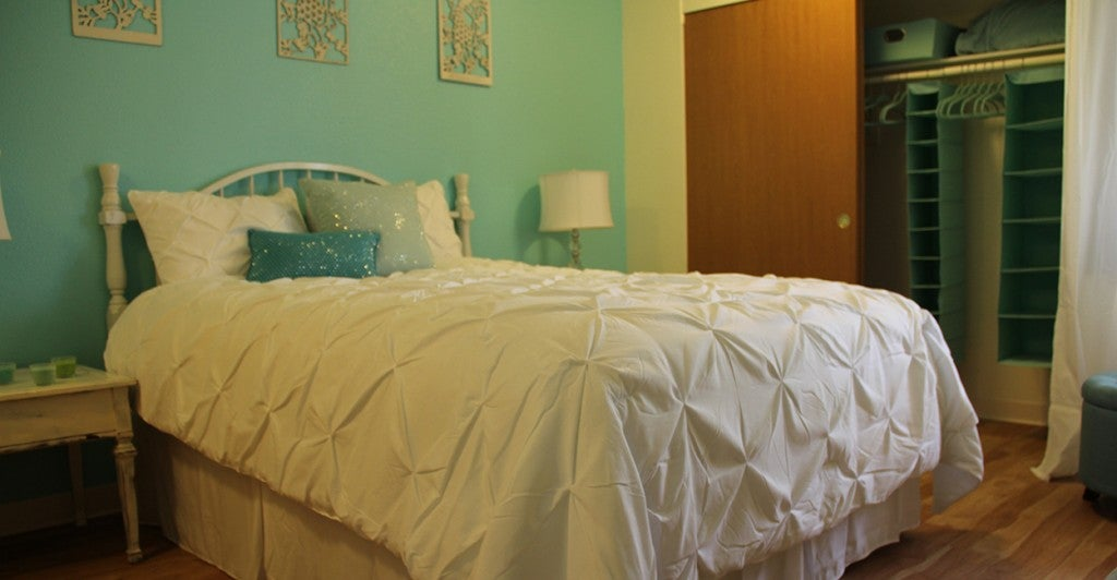 A bedroom in a model unit at Blue Butterfly Village. (Photo: Billy Glading/The Daily Signal)